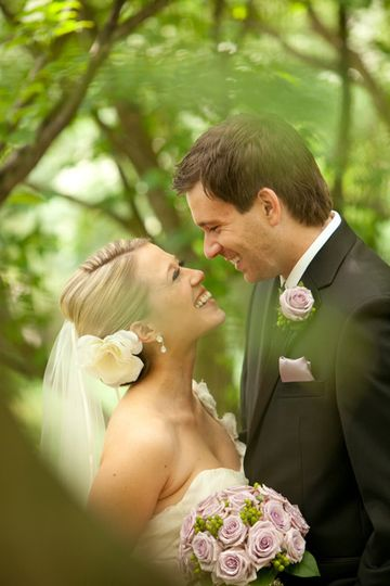 Appleford Mansion in Villanova provided the perfect backdrop for a peek-a-boo kiss in the garden for...