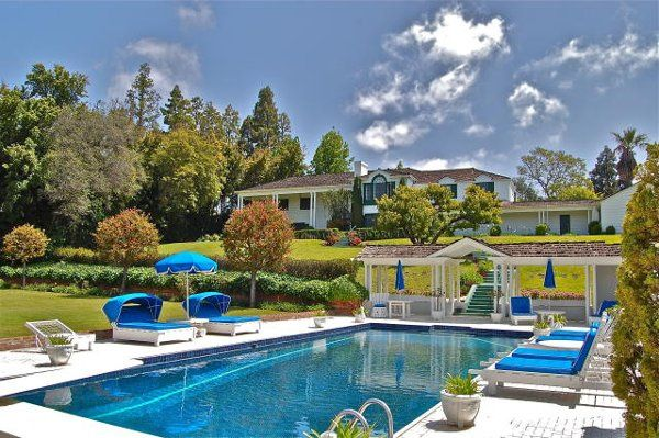 A beautiful 2 acre estate in the heart of Holmby Hills on the best street in the country, across...