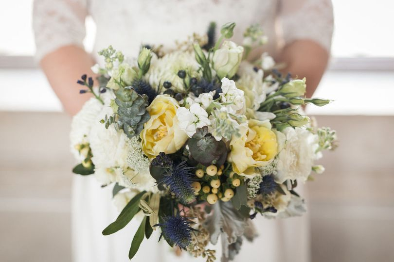 The bride requested whites and ivories with touches of navy blue for her bridal bouquet.