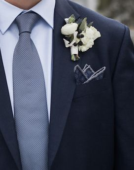 Groom's boutonniere with just a dash of navy.