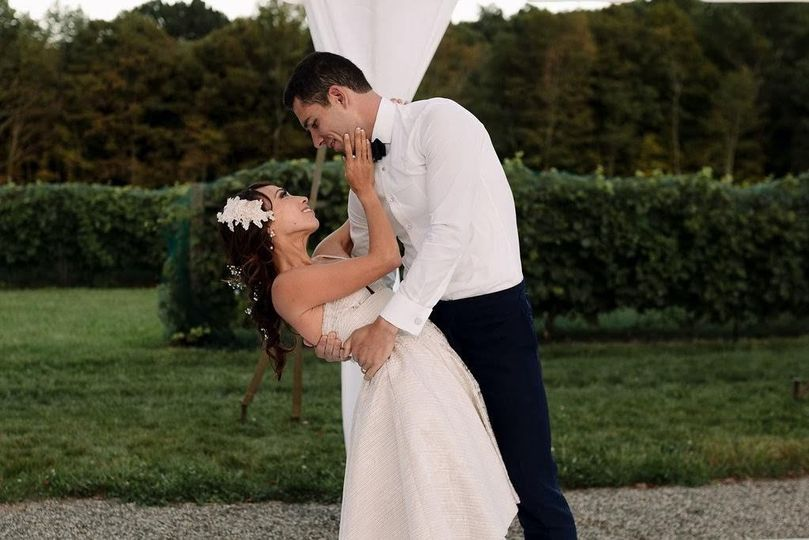 Groom dips his bride