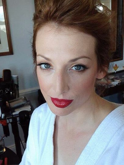 Striking red lip with rosy cheeks