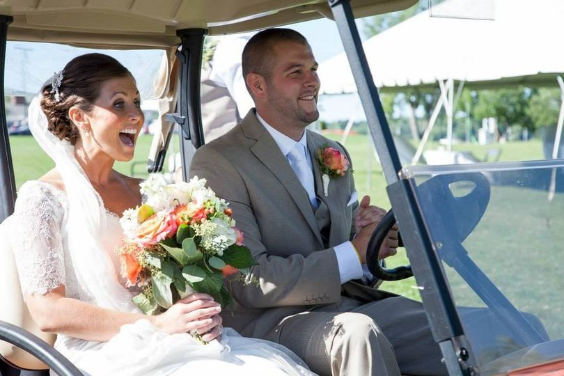 Bride and groom in the Golf cart!!!