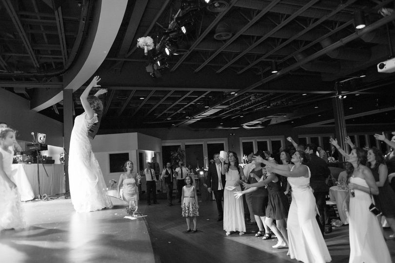The bride tossing her bouquet