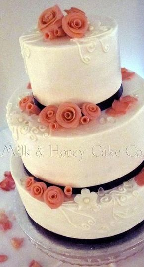 Buttercream wedding cake with three flavors: vanilla with chocolate filling, coconut with coconut...