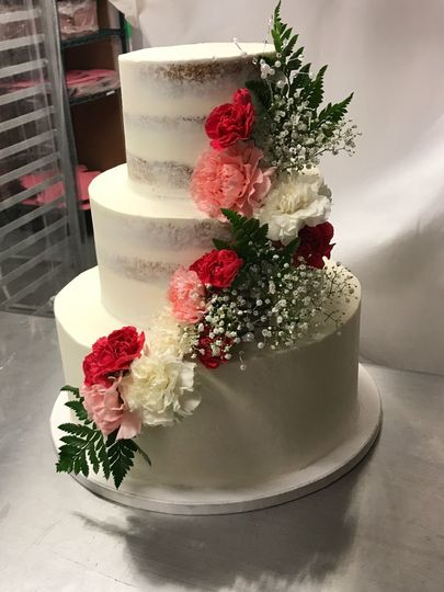 Naked cakes with fresh flowers provided by the bride