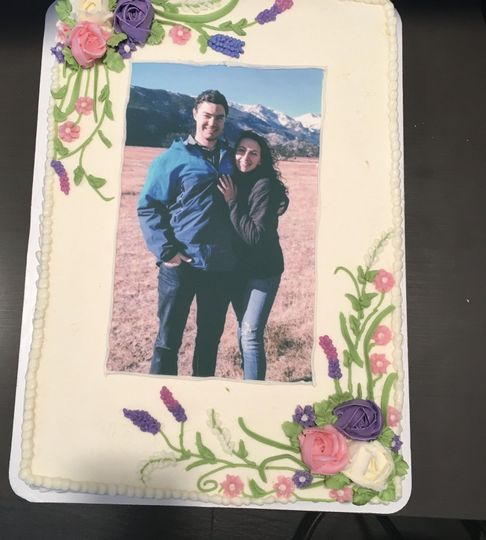 Perfect engagement party cake with edible photos from the actual engagement!