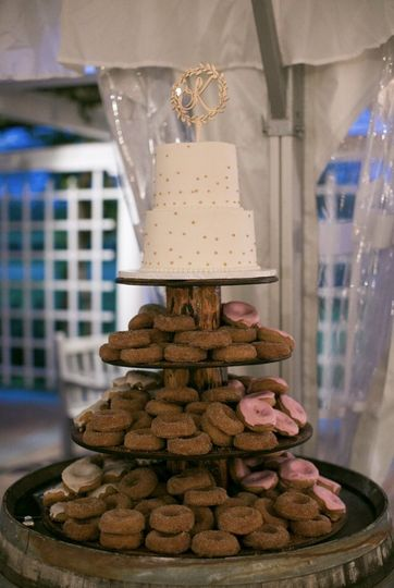 Tiered cake with donuts