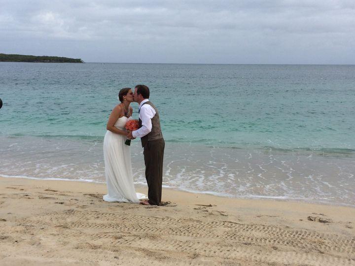 crystal and jason kissing at the waters edge