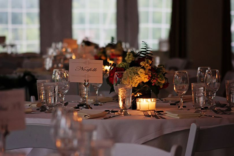 Candlelit reception setup and table decor