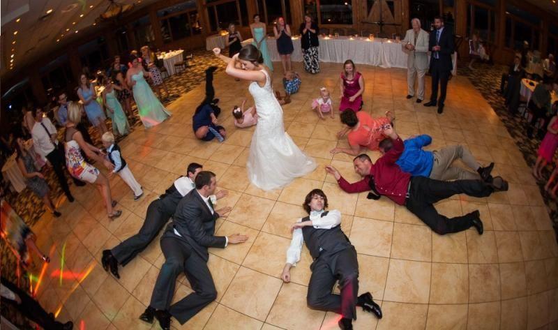 Bride and groomsmen dancing