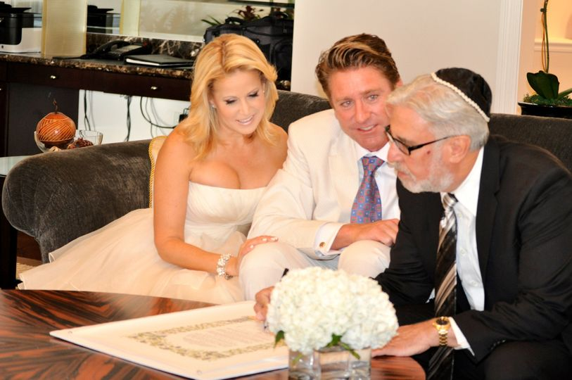 Rabbi Michael signs the Ketubah along with the bride and groom