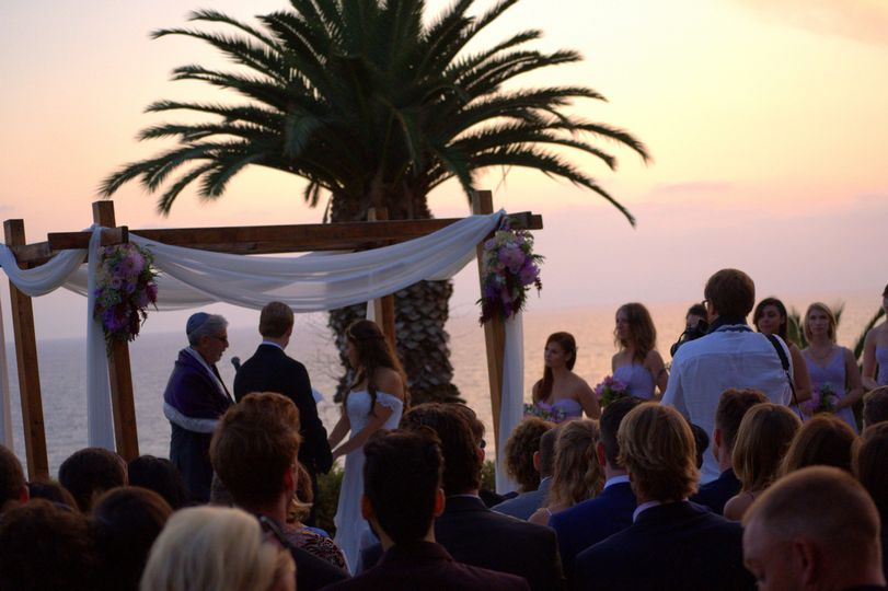 Rabbi Michael Mayersohn officiated this Jewish & Interfaith wedding ceremony as the sunset at the...