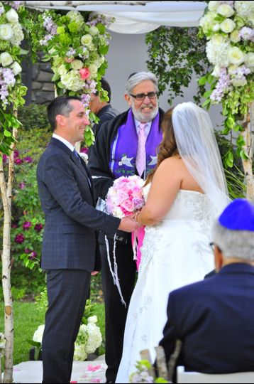Rabbi Michael Mayersohn officiated a Jewish & Interfaith wedding ceremony at a private home in...