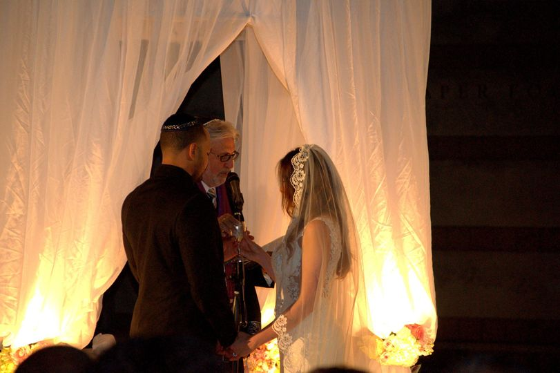 Rabbi Michael Mayersohn officiates a Jewish & Interfaith wedding ceremony at the Skirball Museum in...