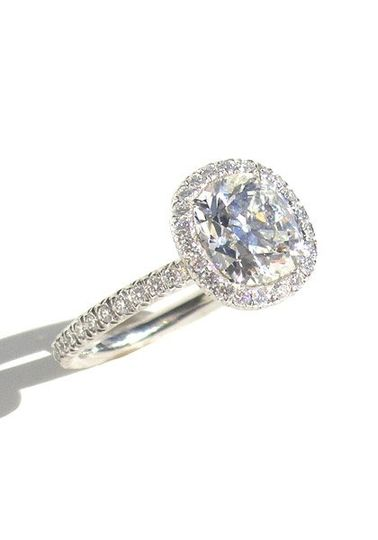 A stunning 2.08 carat cushion brilliant cut diamond engagement ring. This beautiful stone is set in...