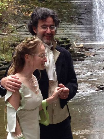 Newlyweds by the waterfall