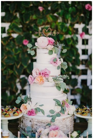 White cake with flowers and leaves