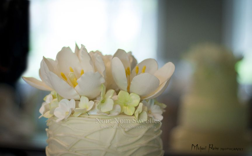 A close up of handmade sugar tulips, parrot tulips, blossoms and hydrangeas.