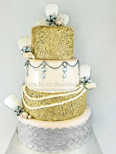 A glam 20's themed cake with all edible details. Sugar feathers, brooches, pearls, roses, and even...