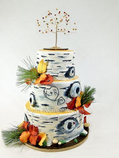 A fall birch tree wedding cake complete with handmade sugar fall leaves and edible details. Topper...