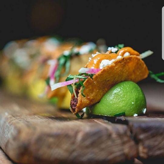 Mini shrimp & potato tacos with salsa matcha, queso fresco & shredded watermelon radish slaw