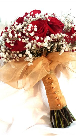 Red Rose & Baby's Breath hand held Bridal bouquet, with the stems wrapped in sheer gold ribbon.