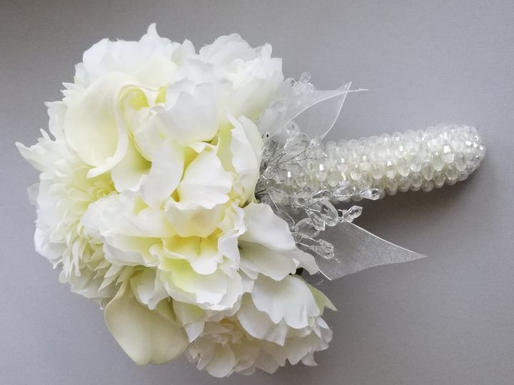 Silk Peonies Ivory Bridal bouquet with the stems wrapped with pearls.