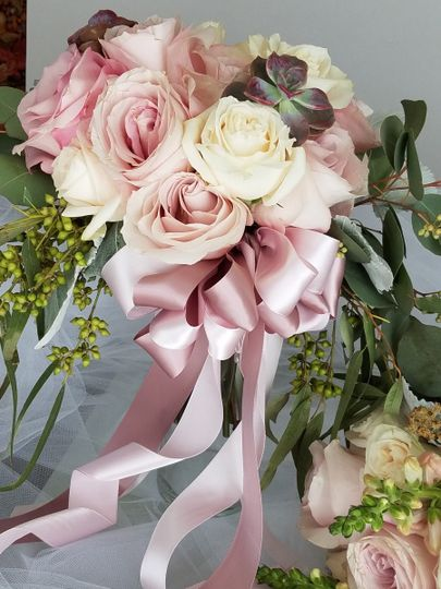 Pink arrangement with ribbons