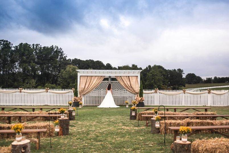 Our outdoor wedding ceremony area with plenty of rustic benches and hay bails for guests to sit on....