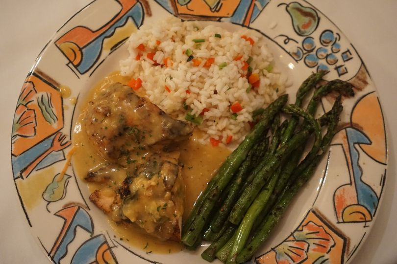 One of Most Popular Dishes: Chicken Spiedini served with a side of rice and asparagus