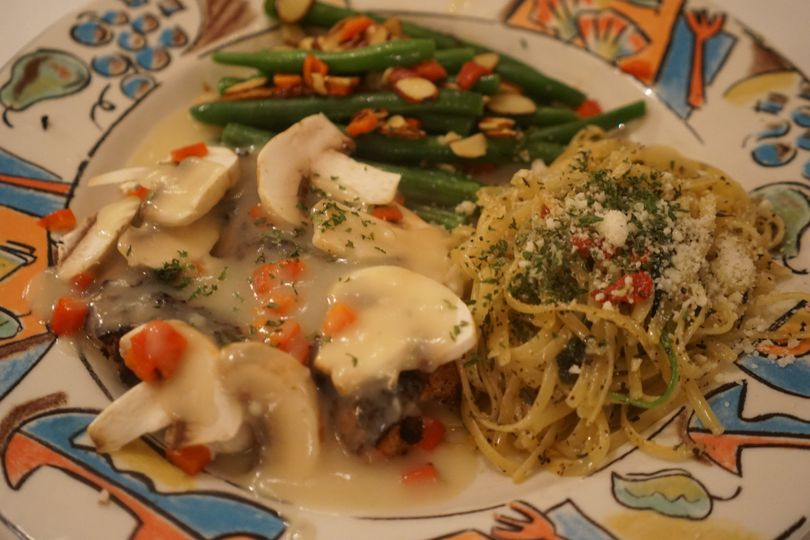 This mouthwatering Grilled Chicken dish is served with Buttered Noodles and Green Beans