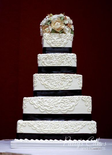 Wedding cake with black flowers