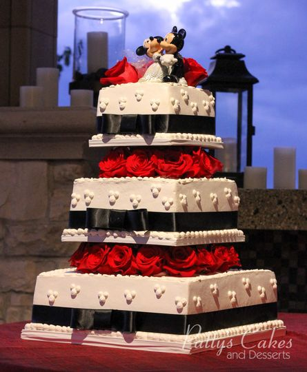 Wedding cake with black ribbons and red roses