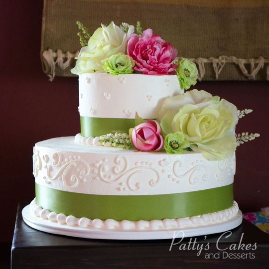 Wedding cake with green ribbons