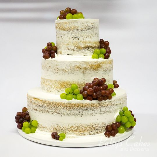 Naked wedding cake with grapes