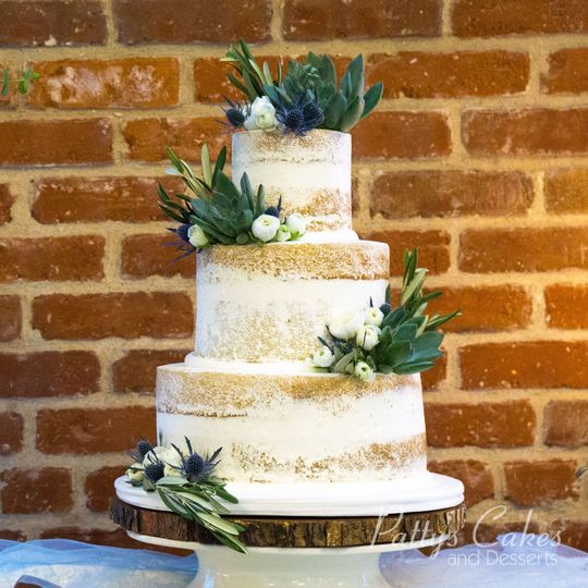 Naked wedding cake with greens