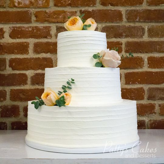 White wedding cake with yellow flowers