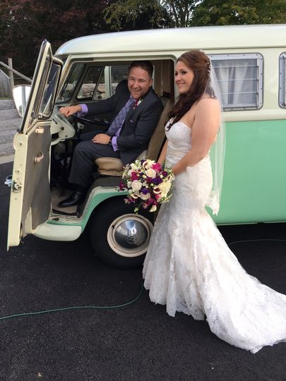 Chloe the VW PhotoBus with a bride and groom at their wedding at Mt. Hope Farm in Bristol, Rhode...