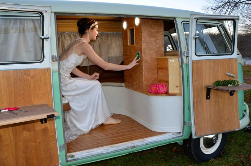 A bride taking selfies inside Chloe the VW photo bus
