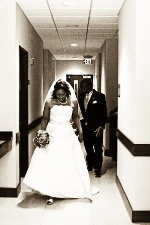 bride and groom hallway