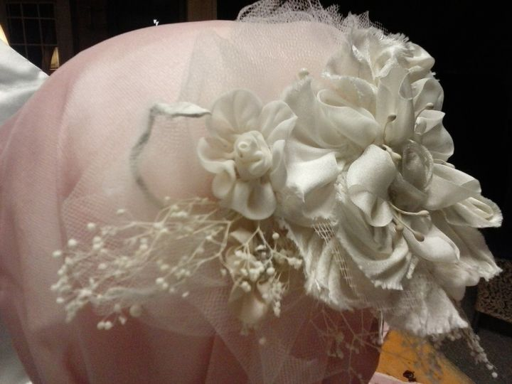 Ericka's headpiece. These handmade flowers are silk.  The structure is handmade and lightweight....