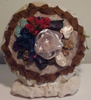 This design dates back to 1914, which is a story in itself.  This brooch is a lovely cluster of...