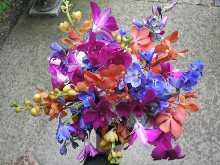 Brides bouquet of orchids and delphinium