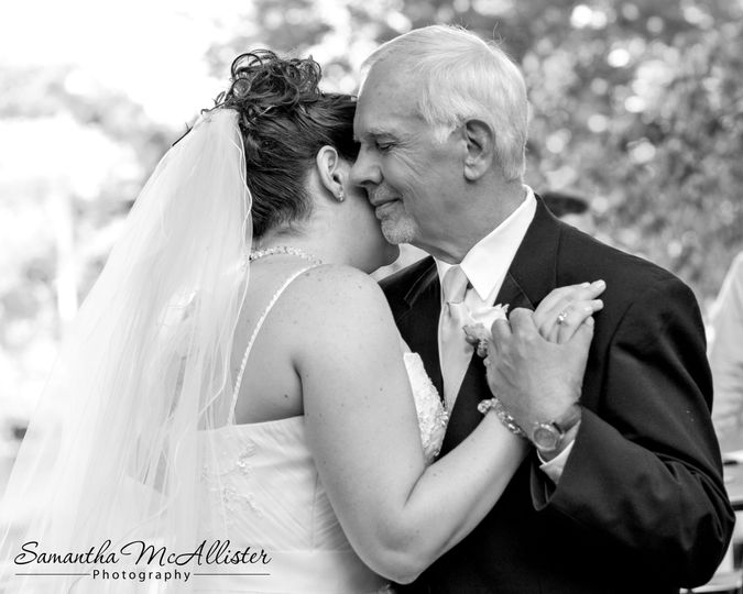 Father and daughter dance during a wedding reception.  The love he has for his daughter is very...