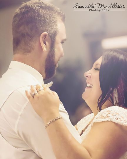 They are having so much fun during the first dance at this wedding reception, and comfortable even...
