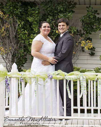 Captured all the nice outside ornamental elements in this posed photograph of the happy newlyweds.