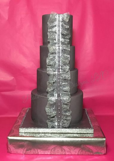 An elegant gray cake with delicate edible silver lace.  This cake mimics fashion forward dresses.