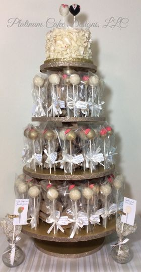 """This 6"""" cream ruffled cake is topped by a bride and groom cake pop.  There are 80 individually..."""