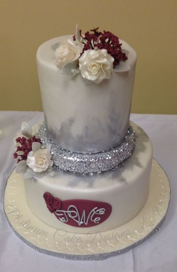 This 3-tiered wedding cake features flowers and colors inspired by the couple's wedding invitation....